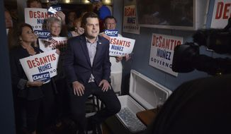 In this Nov. 5, 2018, file photo Rep. Matt Gaetz, R-Fla., gives an interview with the Fox network before speaking at a campaign rally for Republican Florida gubernatorial candidate Ron DeSantis at AJ's Oyster Shanty on Okaloosa Island in Fort Walton Beach, Fla. (Nick Tomecek/Northwest Florida Daily News via AP, File)