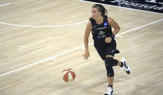 FILE - In this July 25, 2020, file photo, New York Liberty guard Sabrina Ionescu brings the ball up during the second half of the team's WNBA basketball game against the Seattle Storm in Bradenton, Fla. Ionescu is excited to be playing basketball again nearly eight months after spraining her ankle early in her rookie season with the Liberty. (AP Photo/Phelan M. Ebenhack, File)