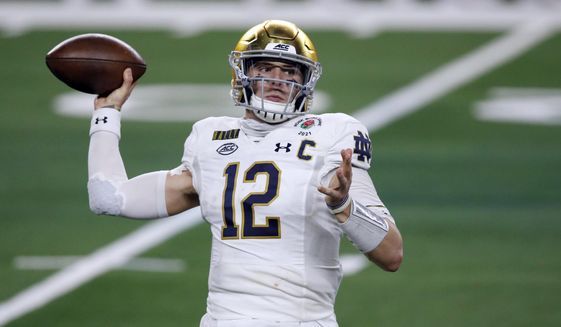 In this Jan. 1, 2021, file photo, Notre Dame quarterback Ian Book (12) throws a pass in the first half of the Rose Bowl NCAA college football game against Alabama in Arlington, Texas. Perhaps the best-known collegian selected in the fourth round Saturday was Book. And Book went somewhere with a QB opening: New Orleans, which saw career passing leader Drew Brees retire. (AP Photo/Roger Steinman, File) **FILE**