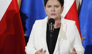 """FILE - In this Thursday, April 18, 2019 file photo, Poland's Deputy Prime Minister Beata Szydlo speaks to reporters in Warsaw, Poland. Relatives of former Polish Auschwitz prisoners are protesting the appointment of a top member of the country's right-wing ruling party to an advisory council at the state-run Auschwitz-Birkenau museum in Poland. They argue that the former prime minster, Beata Szydlo, has tolerated """"openly fascist"""" groups and supported attempts to stifle research into the Holocaust.  (AP Photo/Czarek Sokolowski, file)"""