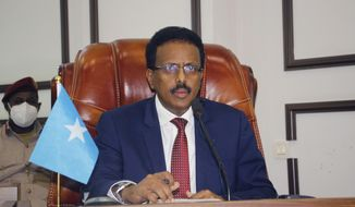 Somalia's President Mohamed Abdullahi Mohamed looks on during a parliamentary session, in Mogadishu, Somalia, Saturday, May 1, 2021. The controversial two-year term extension for Somalia's president has evaporated after intense public pressure as the lower house of parliament has approved his request to instead support efforts to organize the country's long-delayed national election. (AP Photo/Farah Abdi Warsameh)