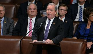 In this Dec. 18, 2019, file photo, Rep. Larry Bucshon, R-Ind., speaks on the House floor at the Capitol in Washington. With vaccination rates lagging in red states, Republican leaders have begun stepping up efforts to persuade their supporters to get the COVID-19 shot, at times combating misinformation spread by some of their own. (House Television via AP)