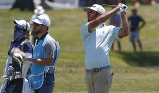 Max Homa, right, looks for the ball after a shot at the ninth hole during the PGA Valspar Championship golf tournament in Palm Harbor, Fla., Friday, April 30, 2021. (Ivy Ceballo/Tampa Bay Times via AP)