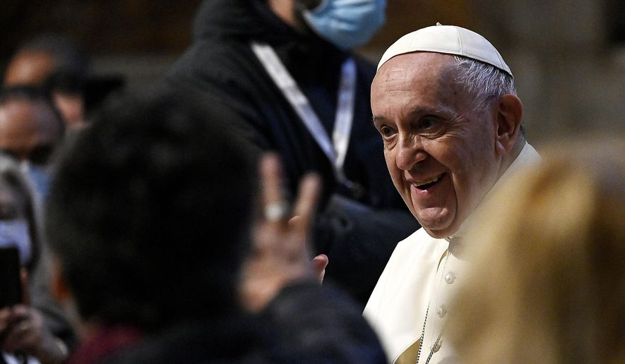 Pope Francis arrives for prayer in the Gregorian Chapel in St. Peter's Basilica at the Vatican, Saturday, May 1, 2021. The pope led a special prayer service Saturday evening to invoke the end of the pandemic. (Riccardo Antimiani/Pool photo via AP)