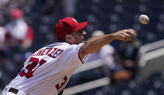 Washington Nationals starting pitcher Max Scherzer throws during the third inning of a baseball game against the Miami Marlins at Nationals Park, Sunday, May 2, 2021, in Washington. (AP Photo/Alex Brandon)