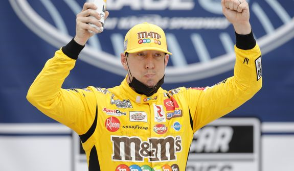 Kyle Busch celebrates in Victory Lane after winning a NASCAR Cup Series auto race at Kansas Speedway in Kansas City, Kan., Sunday, May 2, 2021. (AP Photo/Colin E. Braley)