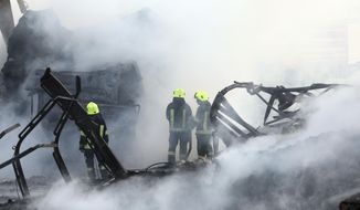 Firefighters work to extinguish burning fuel tankers in Kabul, Afghanistan, Sunday, May 2, 2021. A fire roared through several fuel tankers on the northern edge of the Afghan capital late Saturday, injuring at least 10 people and plunging much of the city into darkness, officials said. (AP Photo/Rahmat Gul)