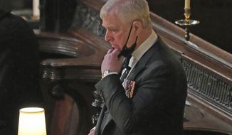 Britain's Prince Andrew inside St. George's Chapel during the funeral of his father, Prince Philip, at Windsor Castle, Windsor, England, Saturday April 17, 2021. Prince Philip died April 9 at the age of 99 after 73 years of marriage to Britain's Queen Elizabeth II. (Yui Mok/Pool via AP)