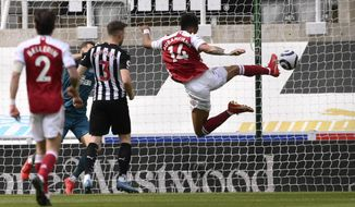 Arsenal's Pierre-Emerick Aubameyang scores his side's second goal during the English Premier League soccer match between Newcastle United and Arsenal at St James' Park stadium, in Newcastle, England, Sunday, May 2, 2021. (Stu Forster/Pool via AP)