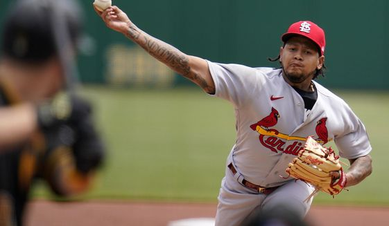 St. Louis Cardinals starting pitcher Carlos Martinez delivers during the first inning of a baseball game against the Pittsburgh Pirates in Pittsburgh, Sunday, May 2, 2021.(AP Photo/Gene J. Puskar)