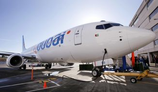 FILE - This Oct. 27, 2010 file photo, shows a Boeing 737 being delivered to flydubai in Seattle, Washington. Dubai's budget carrier flydubai reported Sunday, May 2, 2021, a loss of $194 million in 2020 as revenue fell by more than 50% in what it described as one of the toughest years in the aviation industry. (AP Photo/Elaine Thompson, File)