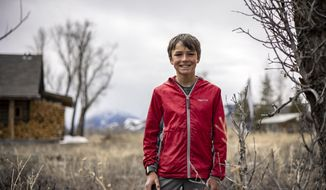 """Charlie von Maur-Newcomb poses in Kelly, Wy., on April 15, 2021. The eleven-year-old created the publication """"Kelly Out Loud"""" in October 2020 as a way to cover his neighborhood on a hyper-local level. """"I came up with the idea of wanting my voice to be heard out loud, in Kelly,"""" he said of his newspaper's title. His favorite part of the reporting process is conducting interviews and getting quotes from Kelly's fellow residents. (Kayla Renie/Jackson Hole News & Guide via AP)"""