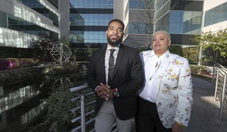 """Mother and son duo Gwen and Davin Clemons, who run Relationships Unleashed, a nonprofit that works """"to create social, cultural, and professional equity for members of the Black LGBTQ + community,"""" pose for a photo outside their new office space, Monday, April 19, 2021, in Memphis, Tenn. They were recently honored by GLAAD Media Awards for their work assisting people living with HIV. (Joe Rondone/The Commercial Appeal via AP)"""