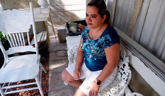 Kenia Cobas, a former Las Vegas buffet helper, who spent 15 years at Green Valley Ranch before her layoff in March 2020, sits outside in Las Vegas on April 14, 2021. Lawmakers are considering a proposal that would require resorts give laid-off workers back the jobs they had before the pandemic. (Ed Komenda/The Reno Gazette-Journal via AP)