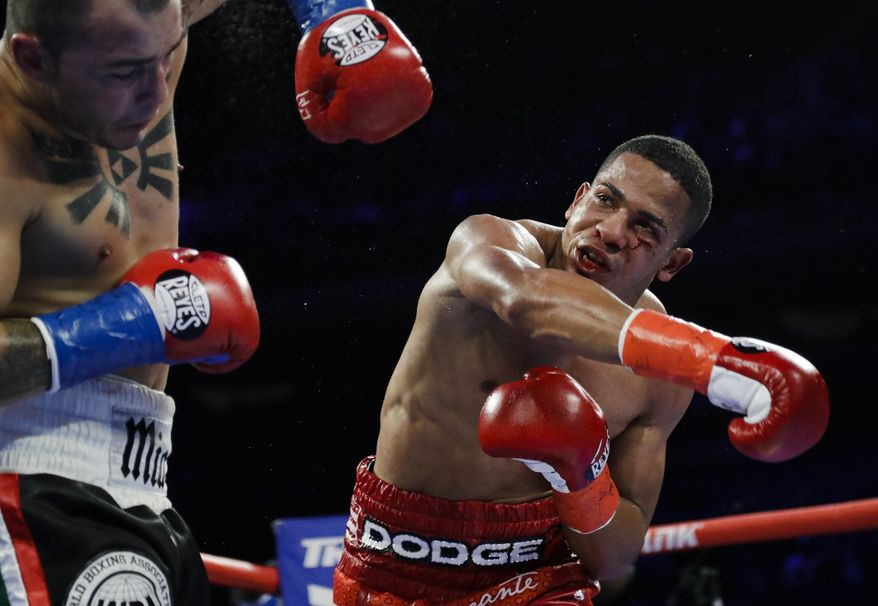 In this April 20, 2019 file photo, Puerto Rico's Felix Verdejo, right, punches Costa Rica's Bryan Vazquez during the fifth round of a lightweight boxing match in New York. Verdejo has turned himself in to federal agents on Saturday, May 1, 2021, just hours after authorities identified the body of his 27-year-old lover Keishla Rodríguez in a lagoon in the U.S. territory, a couple of days after she was reported missing. (AP Photo/Frank Franklin II, File) **FILE**