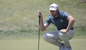 Sam Burns lines up a putt on the first green during the final round of the Valspar Championship golf tournament, Sunday, May 2, 2021, in Palm Harbor, Fla. (AP Photo/Phelan M. Ebenhack)