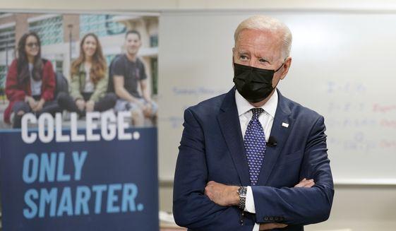 President Joe Biden tours an HVAC workshop at Tidewater Community College, Monday, May 3, 2021, in Portsmouth, Va. (AP Photo/Evan Vucci)