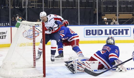 Daniel Sprong, center, of the Washington Capitals scores an unassisted goal in the third period against Igor Shesterkin, right, of the New York Rangers during an NHL hockey game Monday, May 3, 2021, in New York. (Bruce Bennett/Pool Photo via AP) **FILE**