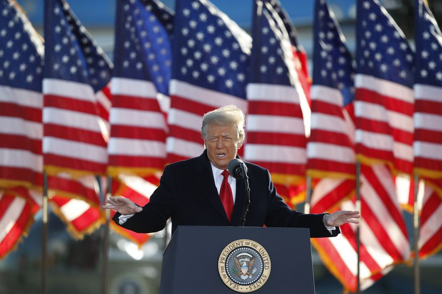 President Donald Trump speaks to a crowd before boarding Air Force One at Andrews Air Force Base, Md., in this Wednesday, Jan. 20, 2021, photo. (AP Photo/Luis M. Alvarez) ** FILE* *