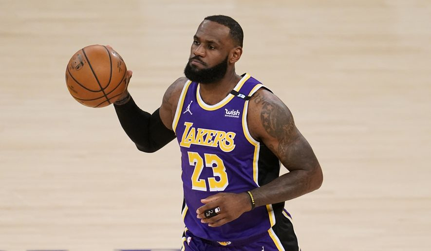 Los Angeles Lakers forward LeBron James dribbles during the first half of an NBA basketball game against the Sacramento Kings Friday, April 30, 2021, in Los Angeles. (AP Photo/Marcio Jose Sanchez)