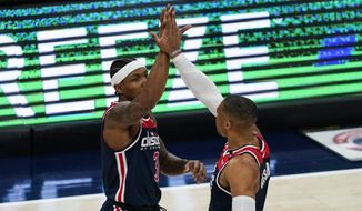 Washington Wizards guard Bradley Beal (3) and Washington Wizards guard Russell Westbrook (4) react after a play during the first half of a basketball game against the Indiana Pacers , Monday, May 3, 2021, in Washington. (AP Photo/Alex Brandon) **FILE**