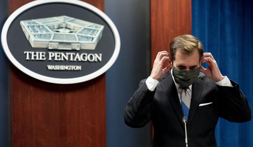 Pentagon spokesman John Kirby puts his mask on following a media briefing at the Pentagon in Washington, Monday, May 3, 2021. (AP Photo/Andrew Harnik)