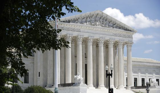 In this June 29, 2020, file photo, the Supreme Court is seen on Capitol Hill in Washington. (AP Photo/Patrick Semansky) ** FILE **