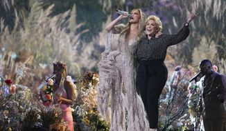 """Jennifer Lopez performs with her mother, Guadalupe Rodríguez, at """"Vax Live: The Concert to Reunite the World"""" on Sunday, May 2, 2021, at SoFi Stadium in Inglewood, Calif. (Photo by Jordan Strauss/Invision/AP)"""