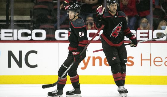 Carolina Hurricanes' Martin Necas (88) celebrates his goal with teammate Nino Niederreiter (21) during the first period of an NHL hockey game against the Chicago Blackhawks in Raleigh, N.C., Monday, May 3, 2021. (AP Photo/Karl B DeBlaker)