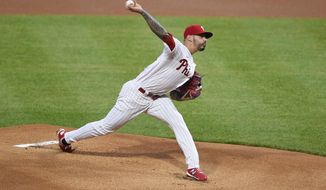 Philadelphia Phillies starting pitcher Vince Velasquez throws the ball during the first inning of a baseball game against the Milwaukee Brewers, Monday, May 3, 2021, in Philadelphia. (AP Photo/Derik Hamilton)