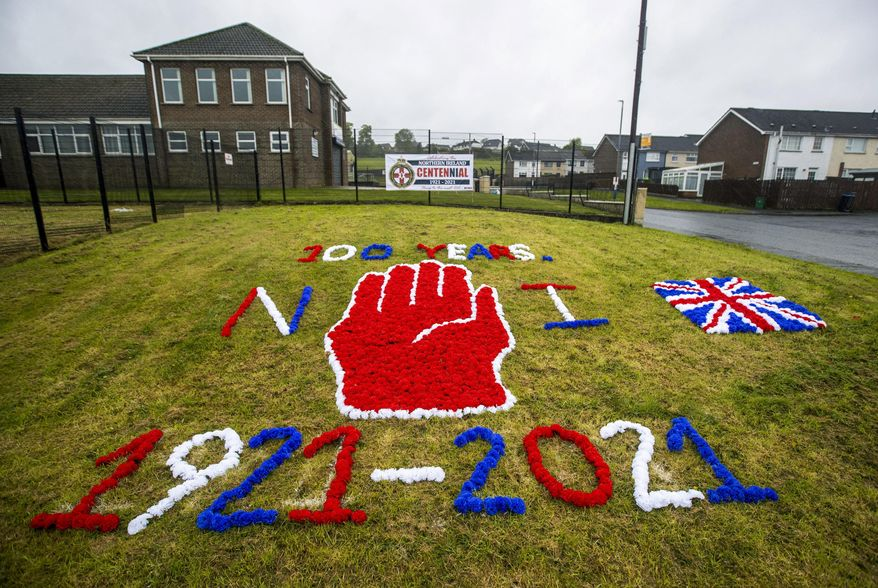 """A display on grass celebrating the 100 year centenary of Northern Ireland, in Ballyduff, Newtonabbey, Northern Ireland, Monday, May 3, 2021. Queen Elizabeth II has stressed the need for """"reconciliation, equality and mutual understanding"""" as she sent her """"warmest best wishes"""" to the people of Northern Ireland to mark what is widely considered to be its centenary. Northern Ireland was created on May 3, 1921, when the Government of Ireland Act came into effect and partitioned the island of Ireland into two separate entities. Northern Ireland became part of the U.K. alongside England, Scotland and Wales. (Liam McBurney/PA via AP)"""