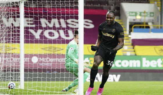 West Ham's Michail Antonio celebrates after scoring his side 2nd goal of the game during the English Premier League soccer match between Burnley and West Ham United and at Turf Moor stadium in Burnley, England, Monday, May 3, 2021. (AP Photo/Jon Super, Pool)
