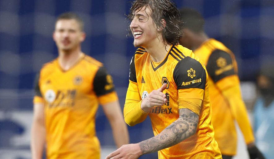 Wolverhampton Wanderers' Fabio Silva celebrates after scoring his side's opening goal during an English Premier League soccer match between West Bromwich Albion and Wolverhampton Wanderers at The Hawthorns in West Bromwich, England, Monday, May 3, 2021. (Jason Cairnduff/Pool via AP)