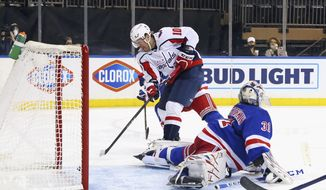 Daniel Sprong, left, of the Washington Capitals scores an unassisted goal in the third period against Igor Shesterkin, right, of the New York Rangers during an NHL hockey game Monday, May 3, 2021, in New York. (Bruce Bennett/Pool Photo via AP)