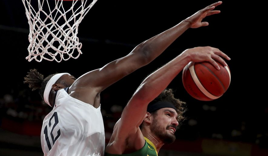 FILE - In this Sept. 9, 2019, file photo, Brazil's Anderson Varejao, right, keeps the ball from United States' Myles Turner during a match for the FIBA Basketball World Cup at the Shenzhen Bay Sports Center in Shenzhen. Varejao is expected to sign with the Cleveland Cavaliers for the remainder of the season after the NBA granted the team an injury exception hardship, a person familiar with the decisions told The Associated Press on Monday, May 3, 2021. (AP Photo/Ng Han Guan, File)