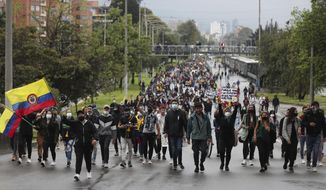 University students march during a national strike against tax reform in Bogota, Colombia, Monday, May 3, 2021. Colombia's President Ivan Duque withdrew the government-proposed tax reform on Sunday. (AP Photo/Fernando Vergara)