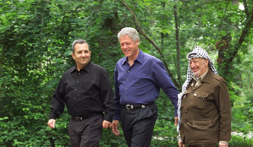 "FILE - President Bill Clinton, center, Israeli Prime Minister Ehud Barak, left, and Palestinian leader Yasser Arafat walk on the grounds of Camp David, Md., at the start of the Mideast summit on July 11, 2000. The documentary ""The Human Factor"" shows the behind-the-scenes story of the U.S.'s effort to secure peace in the Middle East. (AP Photo/Ron Edmonds, File)"