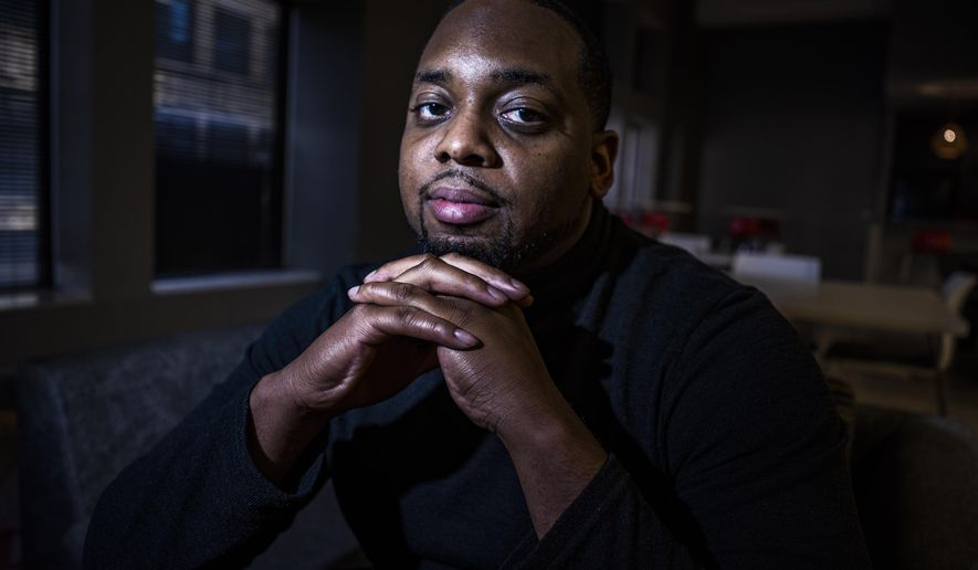 FILE - In this April 28, 2021 file photo, Brandon Mitchell, a juror in the trial of former Minneapolis police Officer Derek Chauvin for the killing of George Floyd, poses for a picture, in Minneapolis. Mitchell defended on Monday, May 3, 2021, his participation in protest in Washington last summer in the wake of online speculation about his motives for serving on the jury. (Richard Tsong-Taatarii/Star Tribune via AP File)