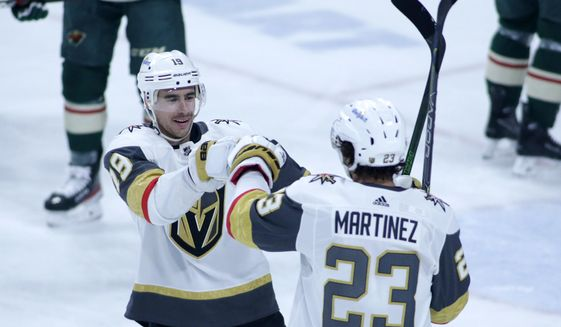 Vegas Golden Knights right wing Reilly Smith (19) and Vegas Golden Knights defenseman Alec Martinez (23) celebrate Martinez's goal against the Minnesota Wild in the first period during an NHL hockey game, Monday, May 3, 2021, in St. Paul, Minn. (AP Photo/Andy Clayton-King)