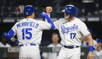 Kansas City Royals Hunter Dozier, right, congratulates Whit Merrifield, left, after Merrifield hit a home run scoring both of them during the fourth inning of a baseball game against the Cleveland Indians Monday, May 3, 2021, in Kansas City, Mo. (AP Photo/Reed Hoffmann)