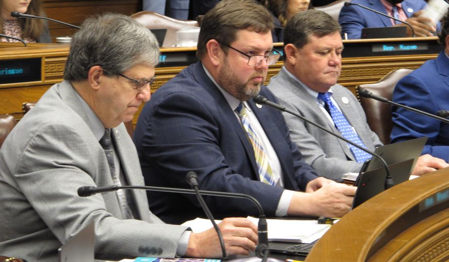 Reps. Bill Wheat, R-Ponchatoula, from left, Chris Turner, R-Ruston; and Troy Romero, R-Jennings, look through budget documents during a meeting of the House Appropriations Committee on Monday, May 3, 2021, in Baton Rouge, La. (AP Photo/Melinda Deslatte)