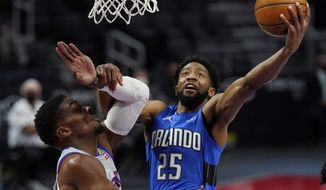 Orlando Magic guard Chasson Randle (25) makes a layup as Detroit Pistons forward Tyler Cook defends during the second half of an NBA basketball game, Monday, May 3, 2021, in Detroit. (AP Photo/Carlos Osorio)