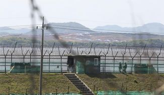 """South Korean army soldiers patrol along the barbed-wire fence in Paju, South Korea, near the border with North Korea, Sunday, May 2, 2021. North Korea on Sunday warned the United States will face """"a very grave situation"""" because President Joe Biden """"made a big blunder"""" in his recent speech by calling the North a security threat and revealing his intent to maintain a hostile policy against it. (AP Photo/Ahn Young-joon)"""
