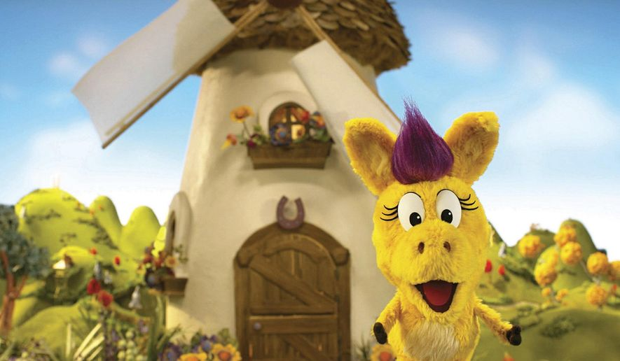 """This image released by PBS Kids shows the puppet Donkey Hodie from the new series, """"Donkey Hodie,"""" inspired from characters in the original Fred Rogers TV show. The whimsical series for children ages 3-5 starts airing Monday and centers on the adventures of Donkey Hodie, an enthusiastic yellow donkey with a bright magenta mane. (Fred Rogers Productions/PBS Kids via AP)"""