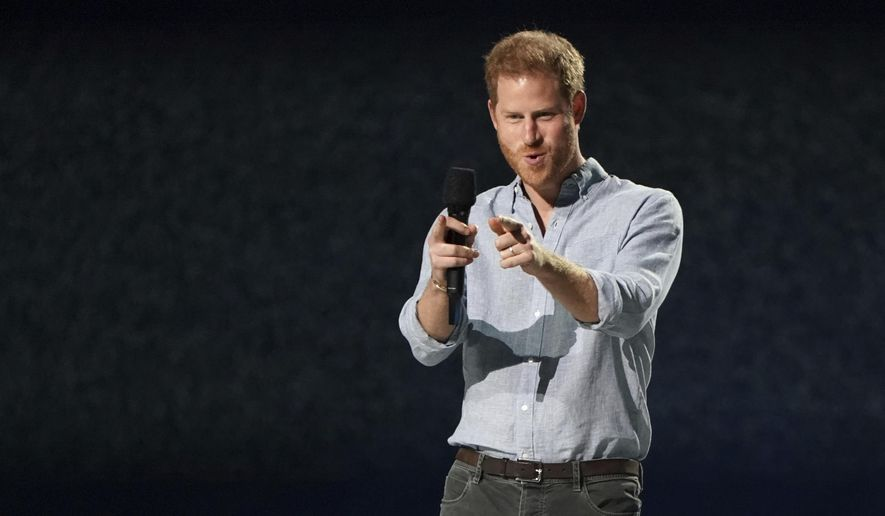 """Prince Harry, Duke of Sussex, speaks at """"Vax Live: The Concert to Reunite the World"""" on Sunday, May 2, 2021, at SoFi Stadium in Inglewood, Calif. (Photo by Jordan Strauss/Invision/AP)"""