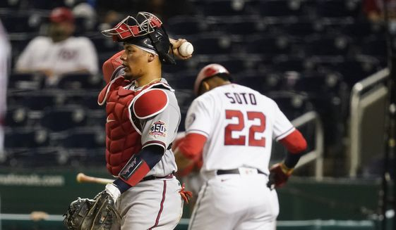Atlanta Braves catcher William Contreras throws the ball back to the pitcher after Washington Nationals' Juan Soto strikes out during the eighth inning of baseball game at Nationals Park, Tuesday, May 4, 2021, in Washington. The Braves won 6-1. (AP Photo/Alex Brandon)