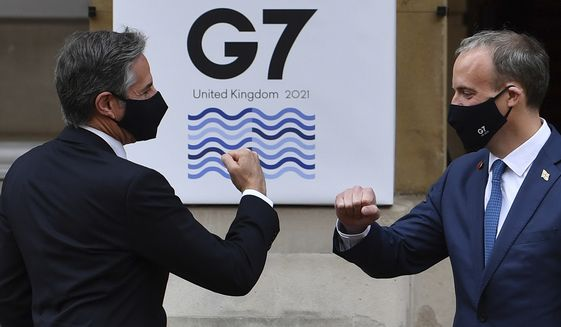 U.S. Secretary of State Antony Blinken, left, is greeted by Britain's Foreign Secretary Dominic Raab at the start of the G-7 foreign ministers meeting in London Tuesday, May 4, 2021.  G7 foreign ministers meet in London Tuesday for their first face-to-face talks in more than two years. (Ben Stansall / Pool via AP)