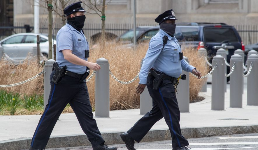 """Police departments are struggling with a shortage of officers because of mass resignations since protests last summer over racism and police brutality, along with calls to """"abolish"""" and """"defund"""" the police. As a result, officers who remain have heavier caseloads. (Associated Press)"""