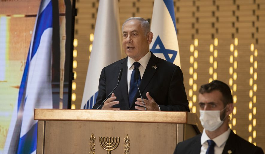 In this Wednesday, April 14, 2021, file photo, Israeli Prime Minister Benjamin Netanyahu speaks at a Memorial Day ceremony at the military cemetery at Mount Herzl, Jerusalem. Netanyahu faces a midnight deadline on Tuesday, May 4, to put together a new coalition government. If he fails, he faces the possibility of leading his Likud party into the opposition for the first time in 12 years. (AP Photo/Maya Alleruzzo, Pool, File)
