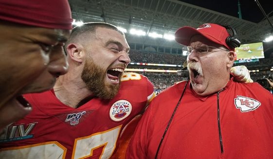 FILE - In this Feb. 2, 2020, file photo, Kansas City Chiefs' Travis Kelce, left, celebrates with head coach Andy Reid after defeating the San Francisco 49ers in the NFL Super Bowl 54 football game in Miami Gardens, Fla. The photo was part of a series of images by photographer David J. Phillip which won the Thomas V. diLustro best portfolio award for 2020 given out by the Associated Press Sports Editors during their annual winter meeting. (AP Photo/David J. Phillip, File)